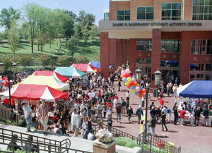 International Festival outdoor photo with attendees and tents in front of the Student Activity Center